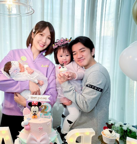 Leanne Li with husband Wong Cho Lam and her two little ladies